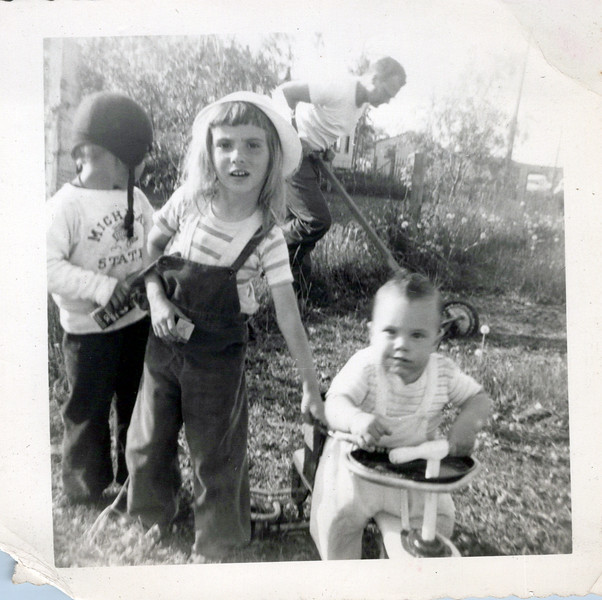 1950 kids with Butch and Doc mowing grass in background.jpeg