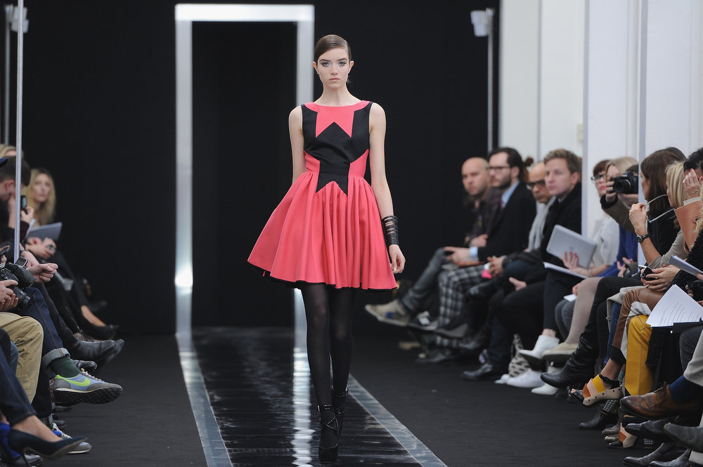 Description of . A model walks the run way during the Maxime Simoens Fall/Winter 2013 Ready-to-Wear show as part of Paris Fashion Week on March 3, 2013 in Paris, France.  (Photo by Pascal Le Segretain/Getty Images)