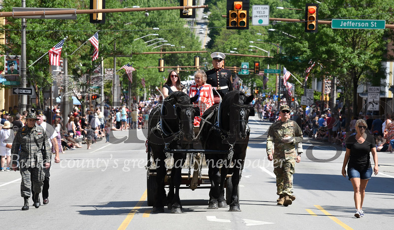 Harold Aughton/Butler Eagle: A horse-drawn wagon carrying one casket with the American flag draped over it marked the beginning of the Butler Memorial Day parade, Monday, May 27.