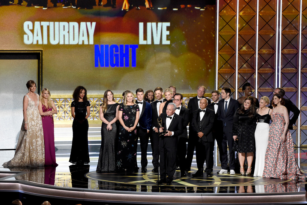 ". Lorne Michaels and the cast of SNL accept the award for outstanding variety sketch series for ""Saturday Night Live\"" at the 69th Primetime Emmy Awards on Sunday, Sept. 17, 2017, at the Microsoft Theater in Los Angeles. (Photo by Chris Pizzello/Invision/AP)"