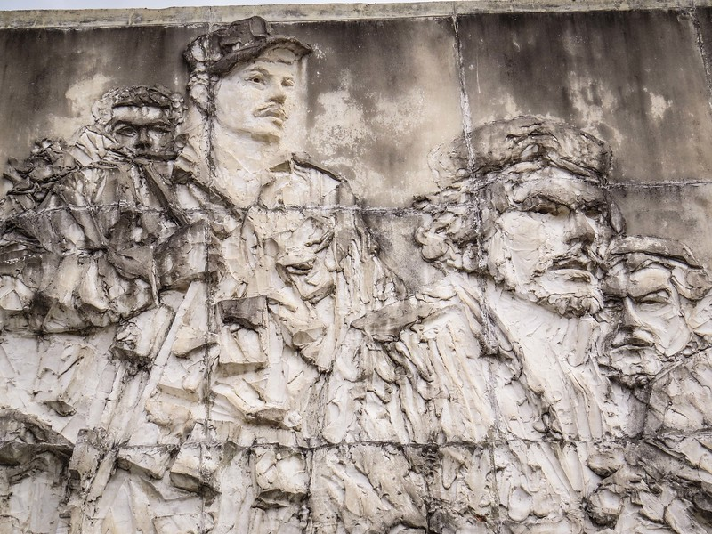 Bas relief sculpture is evocative of their struggles.