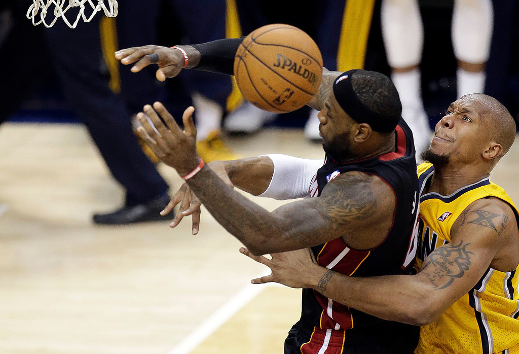 . Indiana Pacers forward David West, right, fouls Miami Heat forward LeBron James during the second half of Game 2 of the NBA basketball Eastern Conference finals in Indianapolis, Tuesday, May 20, 2014. (AP Photo/AJ Mast)