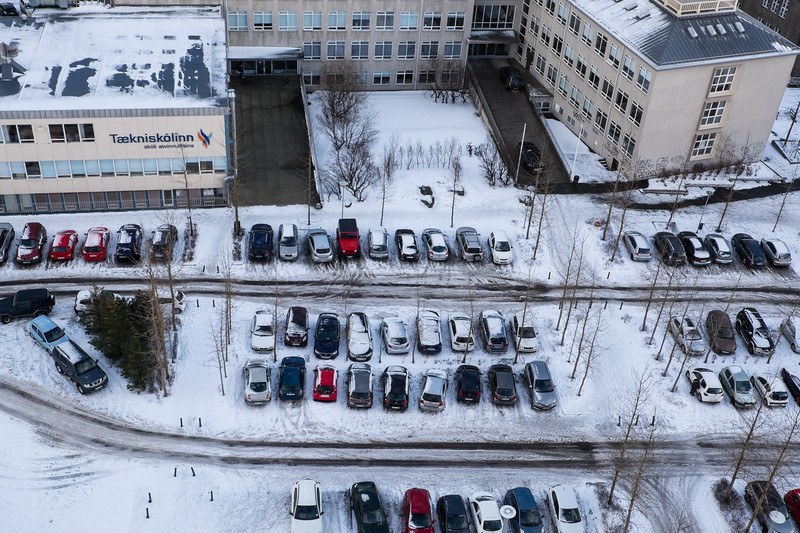 Reykjavik, parking lot. Snowy driving everywhere in the city.