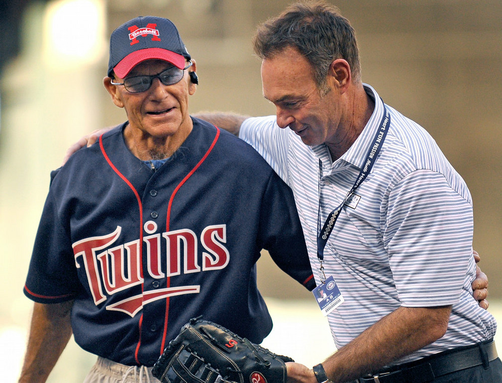. Billy Peterson, who coached former Milwaukee Brewers and Minnesota Twins baseball star Paul Molitor during youth baseball, gets a hug from Molitor after throwing a ceremonial pitch prior to the start of the game between the Brewers and the Twins at Target Field in Minneapolis on Thursday, May 30, 2013.  (Pioneer Press: John Autey)