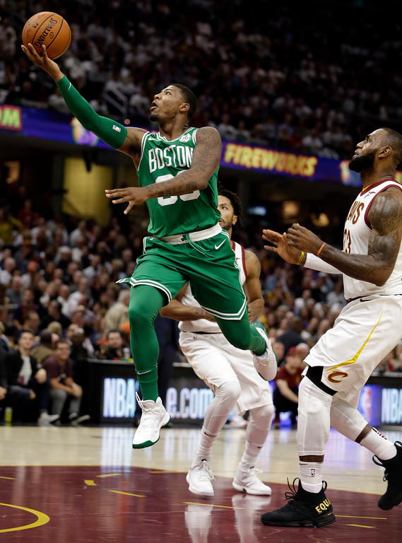 . Boston Celtics\' Marcus Smart (36) drives to the basket against Cleveland Cavaliers\' LeBron James (23) in the first half of an NBA basketball game, Tuesday, Oct. 17, 2017, in Cleveland. (AP Photo/Tony Dejak)