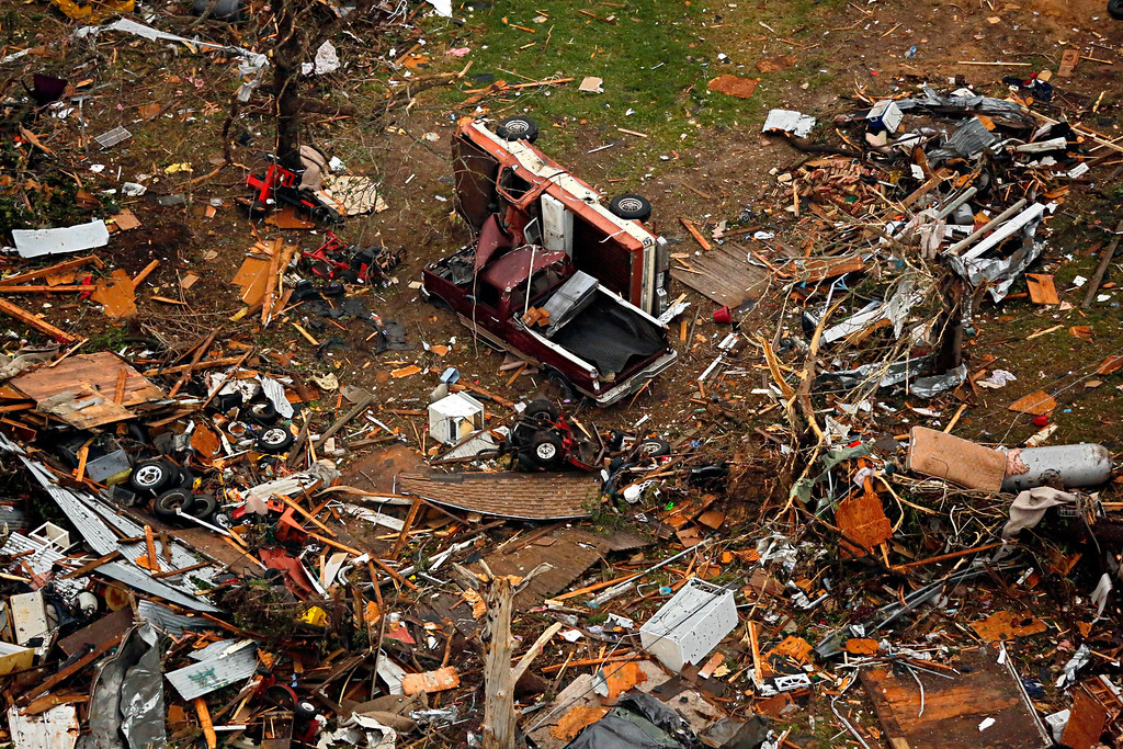 . This aerial photo shows upended trucks among debris caused by Wednesday\'s tornado in Granbury, Texas on Thursday, May 16, 2013.    (AP Photo/The Dallas Morning News, G.J.McCarthy)