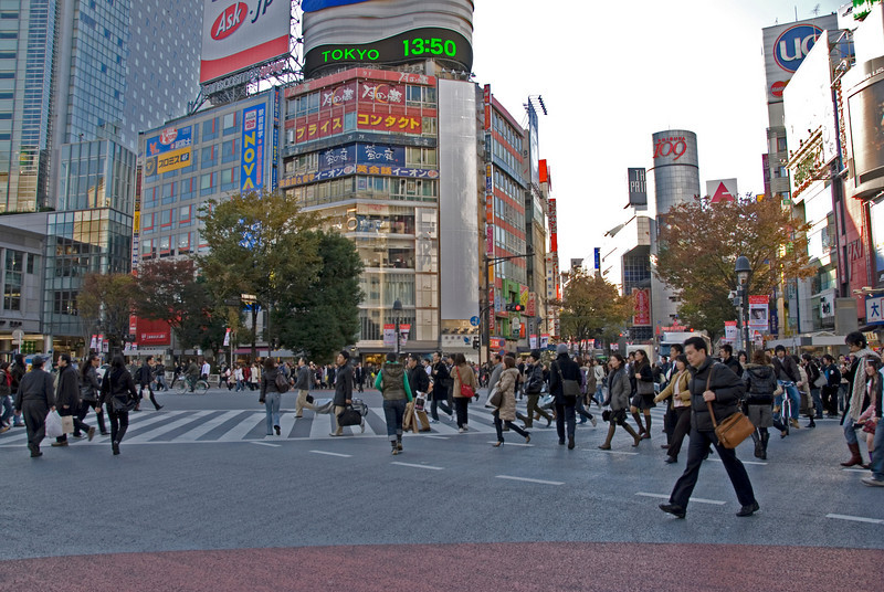 Closer glimpse into pedestrians crossing the Shibuya Intersection in Tokyo, Japan