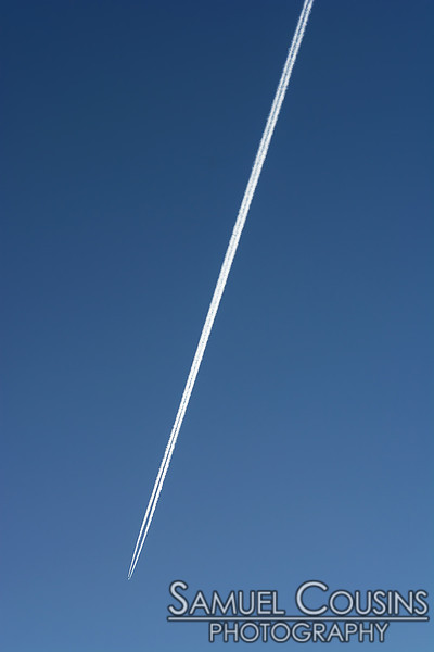 Plane and contrail over Portland.