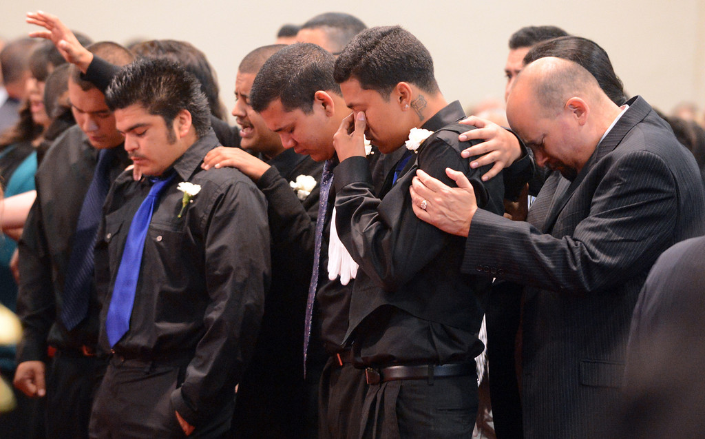 . Young men mourn the loss of Chris Cotinola Jr, during a funeral for the young man in Chino March 21, 2013. Chris Cotinola Jr., the 20-year-old Pomona man who was shot and killed outside his Gordon Street apartment March 10. (Staff photo/Inland Valley Daily Bulletin)