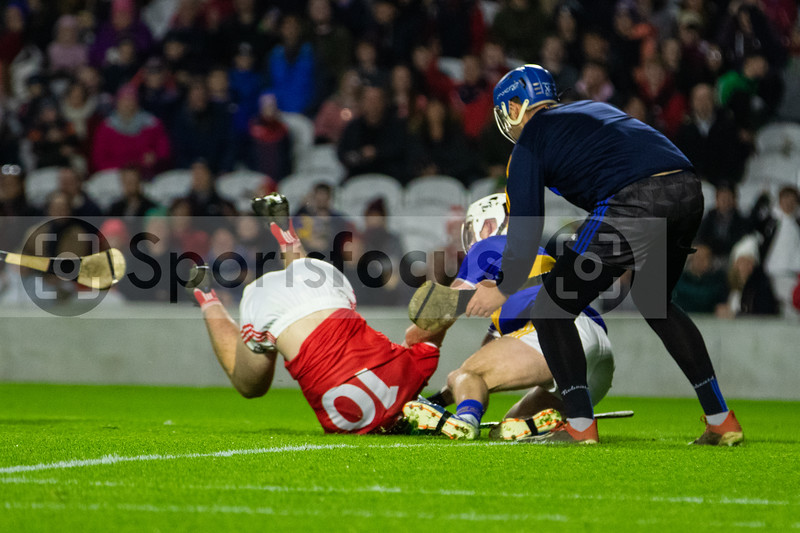 Cork's Robbie O' Flynn is brought down in the square by Tipperary's Sean O'Brien