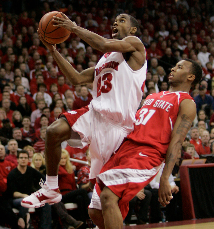 . Wisconsin\'s Kammron Taylor (23) puts up a shot with Ohio State\'s Daequan Cook (31) defending during the second half of a basketball game Tuesday, Jan. 9, 2007, in Madison, Wis. Taylor was the game\'s leading scorer with 25. Wisconsin won 72-69. (AP Photo/Morry Gash)