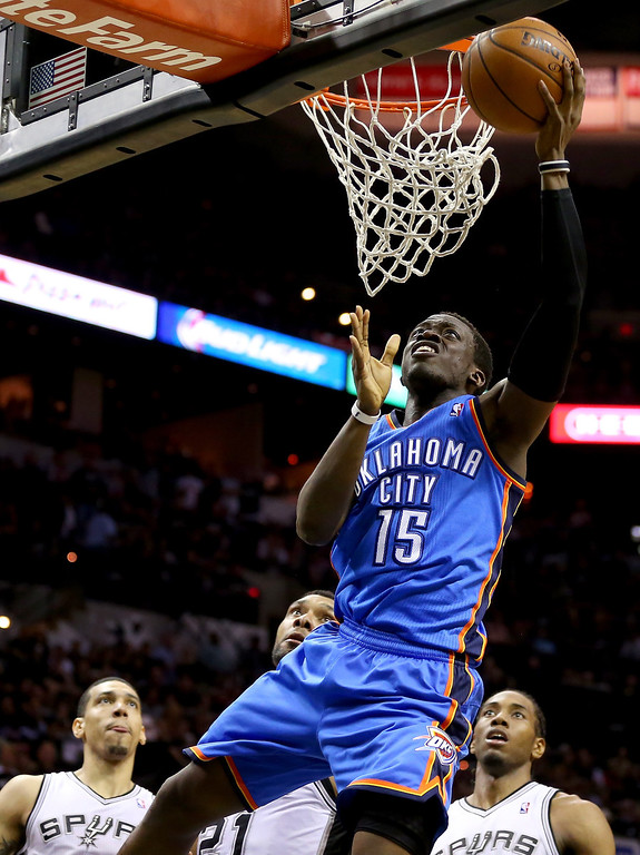 . Reggie Jackson #15 of the Oklahoma City Thunder lays the ball up while taking on the San Antonio Spurs in Game One of the Western Conference Finals during the 2014 NBA Playoffs at AT&T Center on May 19, 2014 in San Antonio, Texas.  (Photo by Ronald Martinez/Getty Images)