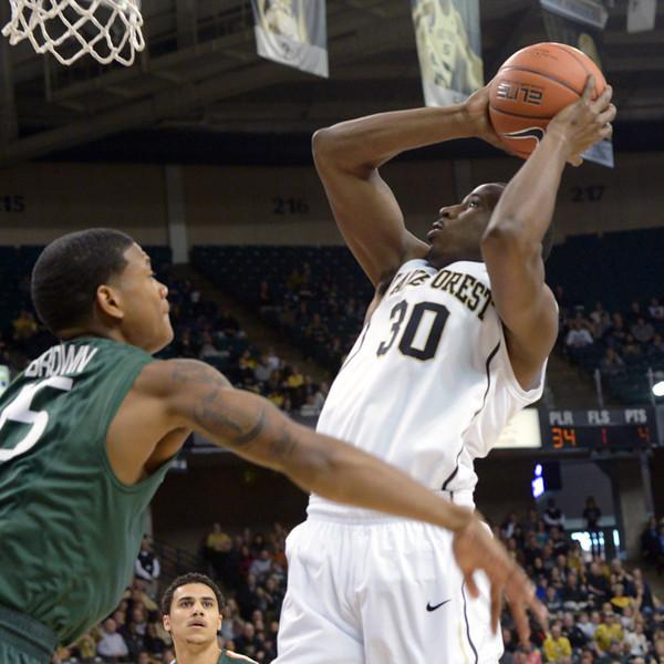 Travis McKie shot under basket.jpg