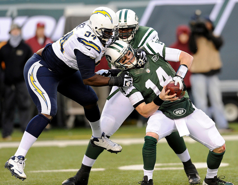 . New York Jets quarterback Greg McElroy, right, is sacked by San Diego Chargers defensive end Corey Liuget, left, during the second half of an NFL football game on Sunday, Dec. 23, 2012, in East Rutherford, N.J. The Chargers won 27-17. (AP Photo/Bill Kostroun)