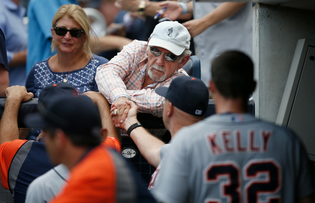 . Former Detroit Tigers manager Jim Leyland, attending the game as a fan, greets Tigers staff and players before the Tigers baseball game against the New York Yankees at Yankee Stadium in New York, Thursday, Aug. 7, 2014.  (AP Photo/Kathy Willens)