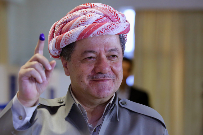 Description of . Kurdish regional President Massoud Barzani shows his ink-stained finger after casting his vote inside a polling station for parliamentary elections in Salah al-Din resort, Irbil, north of Baghdad, Iraq, Wednesday, April 30, 2014. Iraq is holding its third parliamentary elections since the U.S.-led invasion that toppled dictator Saddam Hussein. More than 22 million voters are eligible to cast their ballots to choose 328 lawmakers out of more than 9,000 candidates. (AP Photo)