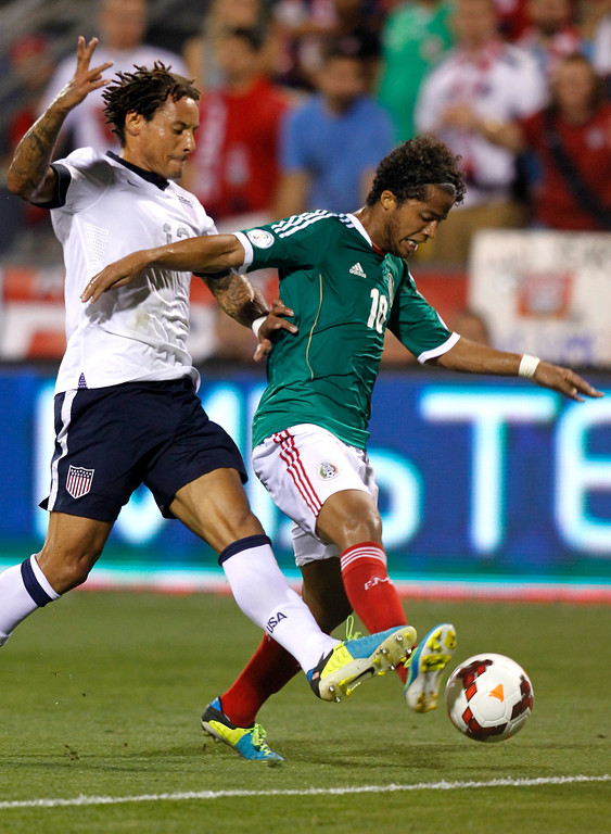. Andres Guardado (R) of Mexico and Jermaine Jones (13) of USA fight for the ball during the first half of their Brazil 2014 FIFA World Cup qualifier at Columbus Crew Stadium in Columbus, Ohio, September 10, 2013.  AFP PHOTO / PAUL VERNONPaul VERNON/AFP/Getty Images