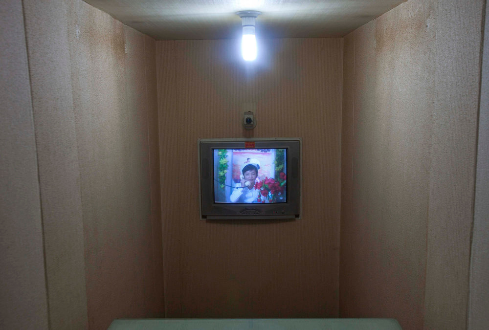 Description of . A North Korean nurse speaks by video conference and telephone to a doctor inside a maternity hospital in Pyongyang, North Korea on Tuesday Oct. 11, 2011. (AP Photo/David Guttenfelder)