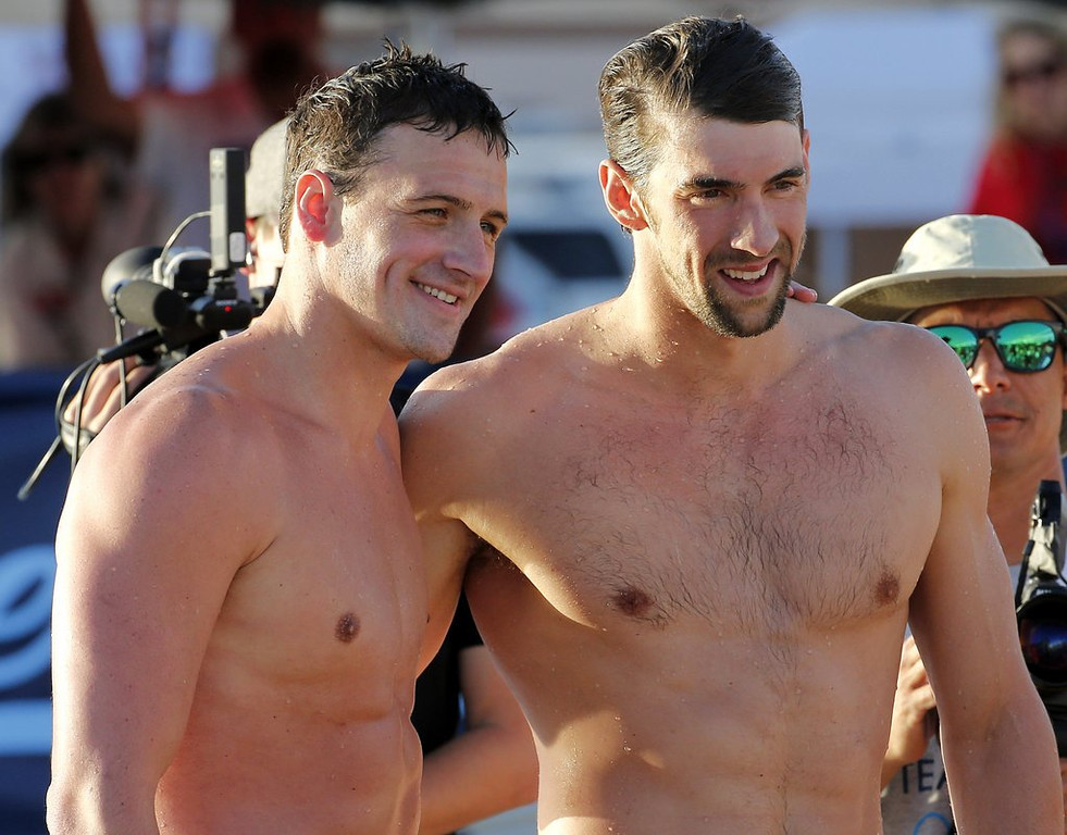 """. 9. MICHAEL PHELPS: Losing comeback race to Ryan Lochte had to be a real p*sser. (unranked) <p><b><a href=\'http://www.twincities.com/sports/ci_25630179/michael-phelps-wins-100-fly-heat-comeback-meet\' target=\""""_blank\""""> LINK </a></b> <p>   (AP Photo/Matt York)"""