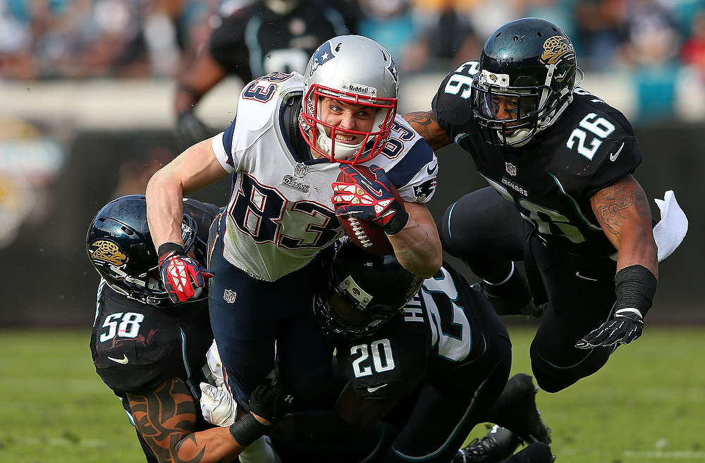 . Wes Welker #83 of the New England Patriots dives after a catch during a game against the Jacksonville Jaguars at EverBank Field on December 23, 2012 in Jacksonville, Florida.  (Photo by Mike Ehrmann/Getty Images)