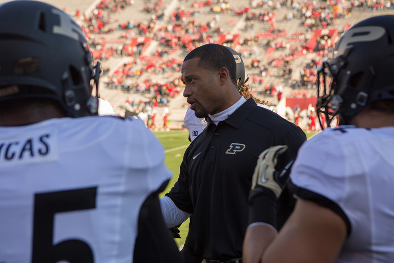 Linebackers coach Marcus Freeman makes a point prior to the game