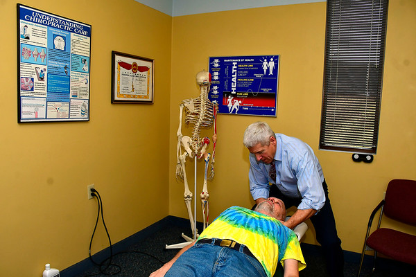 11/20/2019 Mike Orazzi | Staff Bristol Chiropractor Dr. Glen Palmisano works with patient Jerry Stowel.