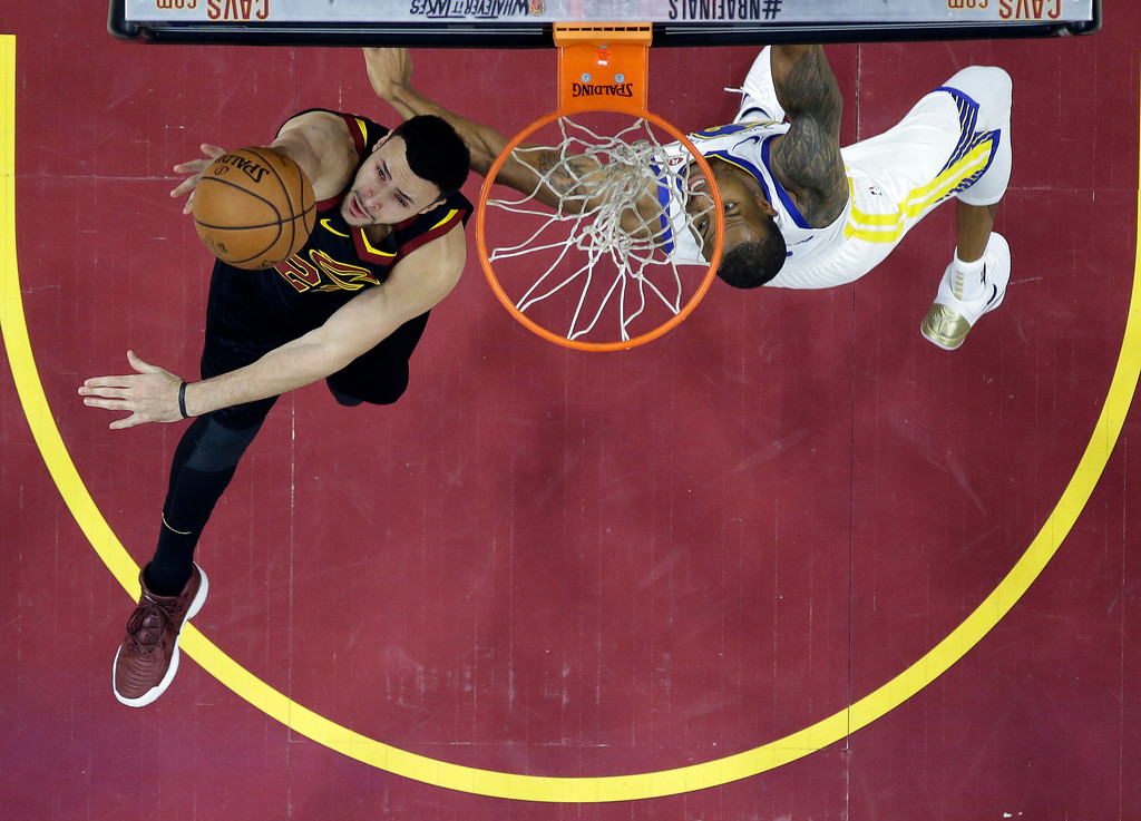 . Cleveland Cavaliers\' Larry Nance Jr., left, shoots next to Golden State Warriors\' Andre Iguodala during the first half of Game 3 of basketball\'s NBA Finals, Wednesday, June 6, 2018, in Cleveland. (AP Photo/Carlos Osorio, Pool)