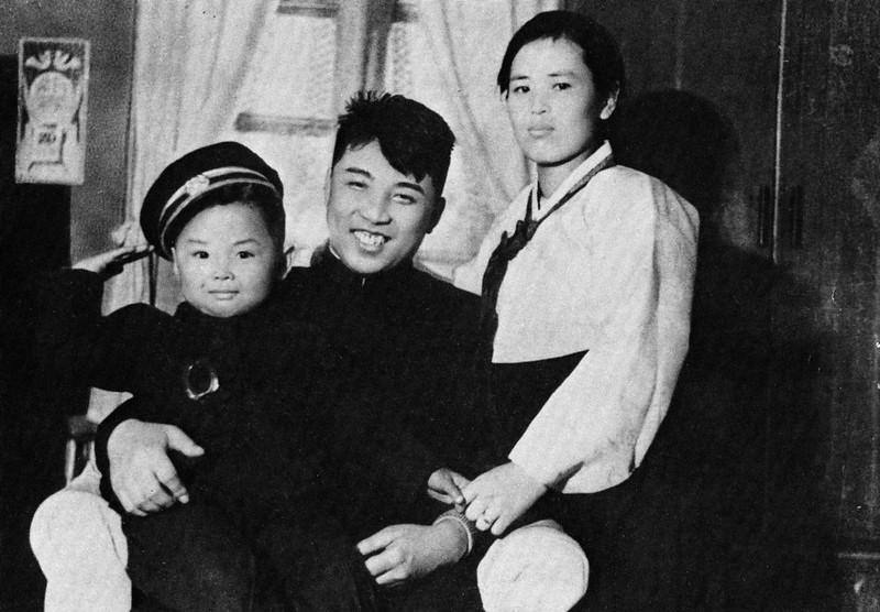 . In this undated photo from North Korea\'s official Korean Central News Agency, distributed by Korea News Service, Kim Jong Il (left) takes part of a souvenir picture during his childhood with his parents, Kim Jong Suk, right, and leader Kim Il Sung. (Korean Central News Agency/Korea News Service via AP Images)