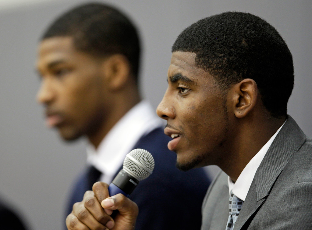 . Kyrie Irving, right, answers questions during a news conference, Friday, June 24, 2011, in Independence, Ohio. Irving was the No. 1 overall pick in the NBA Draft. Tristan Thompson, left, the No. 4 overall basketball pick, listens. (AP Photo/Tony Dejak)
