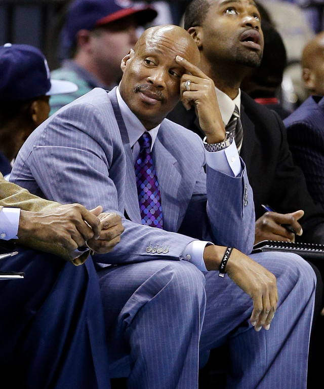 . Cleveland Cavaliers head coach Byron Scott watches from the bench during the first half of an NBA basketball game against the Charlotte Bobcats in Charlotte, N.C., Wednesday, April 17, 2013. (AP Photo/Chuck Burton)