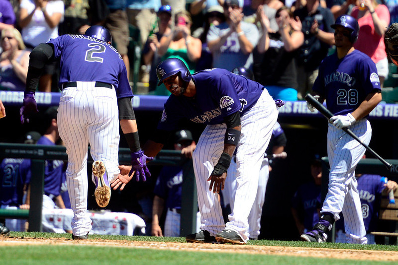 . Colorado Rockies shortstop Troy Tulowitzki (2) low fives center fielder Dexter Fowler (24) after hitting a home run off of San Diego Padres starting pitcher Clayton Richard (33) during the first inning in Denver. The Colorado Rockies hosted the San Diego Padres at Coors Field on Sunday, June 9, 2013. (Photo by AAron Ontiveroz/The Denver Post)