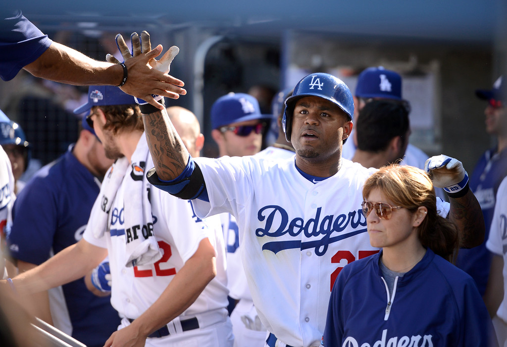 . The Dodgers\' Carl Crawford is congratulated after hitting a 5th inning homerun against the Cardinals in game 5 of the NLCS at Dodger Stadium Wednesday, October 16, 2013.(David Crane/Los Angeles Daily News)
