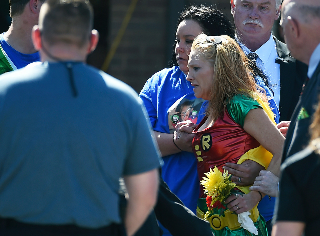 . Renae Hall, right, mother of Jacob Hall, reacts as her son is placed into a hearse during a superhero-themed funeral service for Jacob Hall at Oakdale Baptist Church on Wednesday, Oct. 5, 2016, in Townville, S.C. A 14-year-old boy killed his own father, then drove to Townville Elementary and fired on two children and a teacher as recess began.  Jacob died Saturday.  (AP Photo/Rainier Ehrhardt)