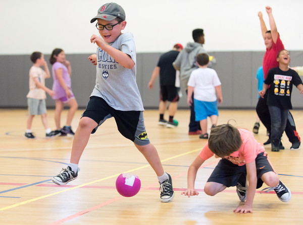 07/23/18 Wesley Bunnell | Staff Cameron Nadeau, L age 7, jumps over a ball during a game of dodge ball on Monday afternoon at the Boys and Girls Club of Bristol as Kody Dragon, age 9, ducks out of the way.