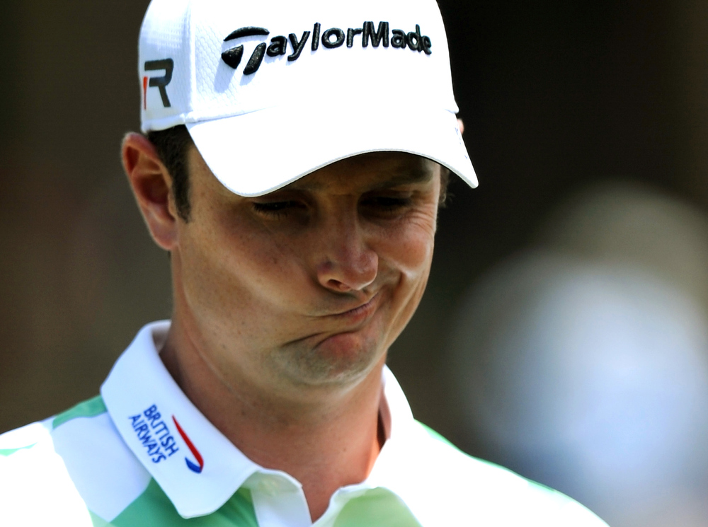 Description of . Justin Rose of England plays during the second round of the 77th Masters golf tournament at Augusta National Golf Club on April 12, 2013 in Augusta, Georgia.   JIM WATSON/AFP/Getty Images