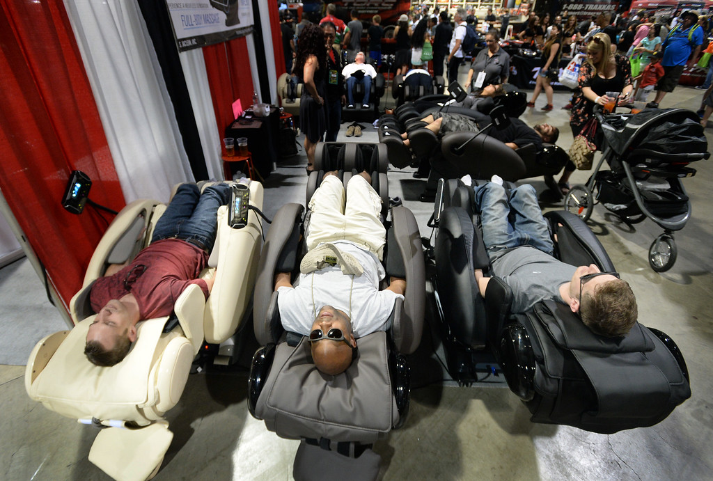 . People give massage chairs a try in the Lifestyle Expo of the Toyota Grand Prix of Long Beach Friday, April 17, 2015, Long Beach, CA.   Photo by Steve McCrank/Staff Photographer