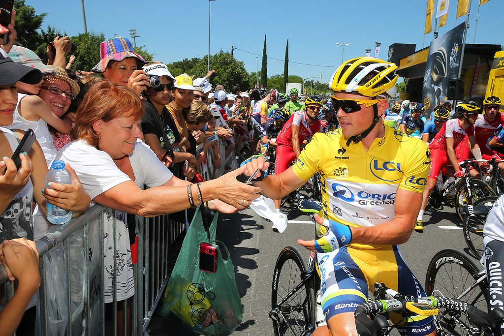 . AIX-EN-PROVENCE, FRANCE - JULY 04:  Simon Gerrans of Australia and Orica Greenedge signs an autograph prior to stage six of the 2013 Tour de France, a 176.5KM road stage from Aix-en-Provence to Montpellier, on July 4, 2013 in Aix-en-Provence, France.  (Photo by Bryn Lennon/Getty Images)