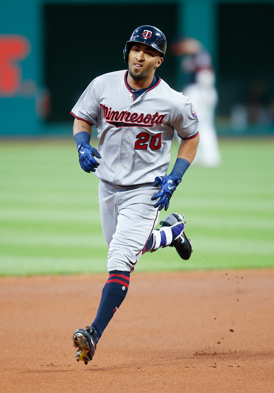 . Minnesota Twins\' Eddie Rosario rounds the bases after hitting a solo home run off Cleveland Indians starting pitcher Josh Tomlin during the first inning in a baseball game, Tuesday, Sept. 26, 2017, in Cleveland. (AP Photo/Ron Schwane)