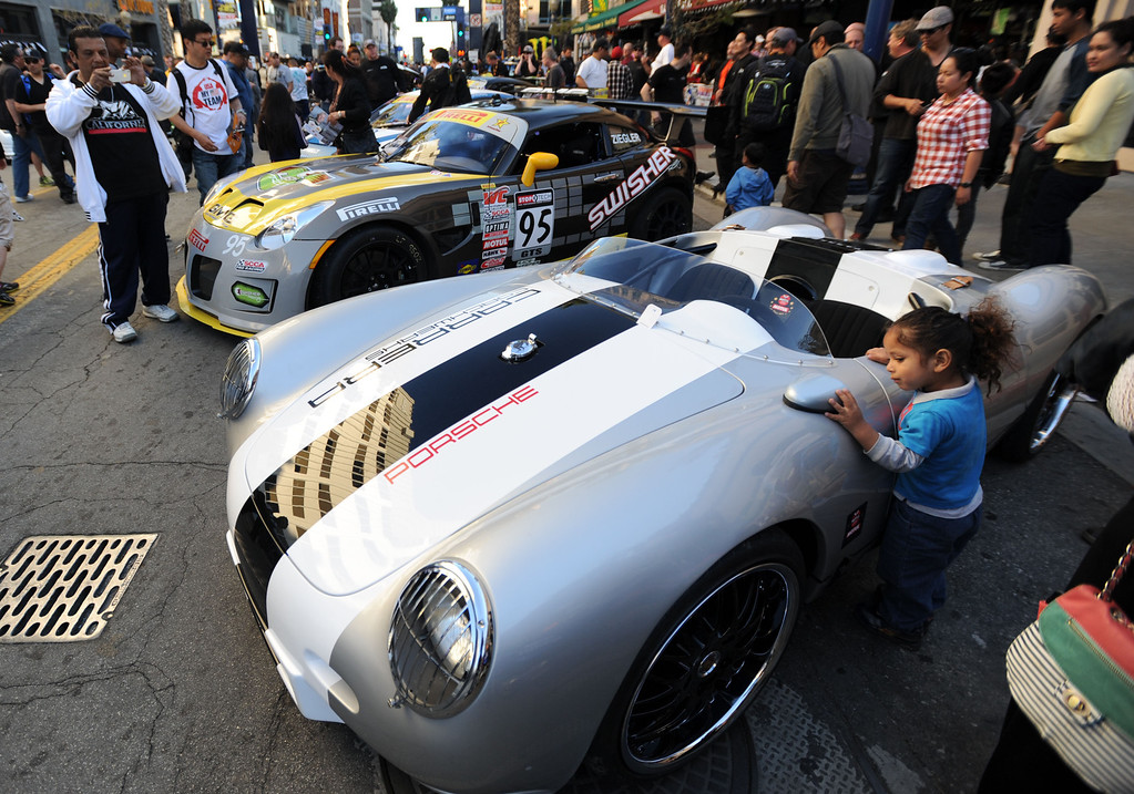 . Long Beach, Calif., -- 04-18-13- Fans got a close-up look at race cars along Pine Ave. during the  Tecate Light Thunder Thursday On Pine.  Race fans were able to  meet drivers and see and IndyCar pit demonstrations.   Stephen Carr/  Los Angeles Newspaper Group