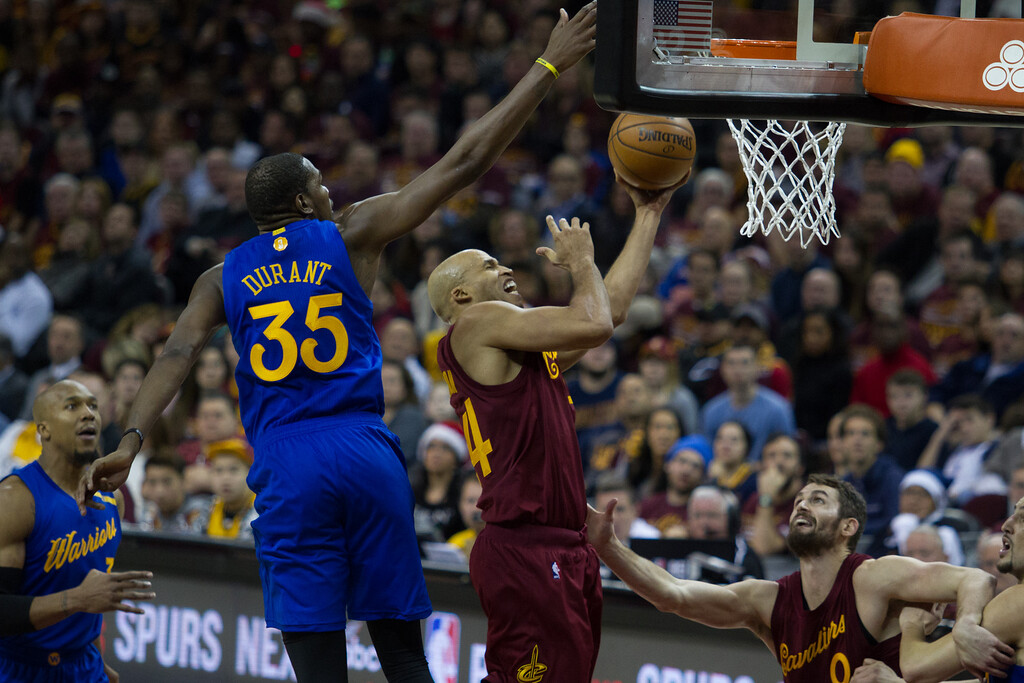 . Richard Jefferson (24) of the Cleveland Cavaliers goes up for a lay up against the Warriors\' Kevin Durant (35) during an NBA game at the Quicken Loans Arena on Christmas day.  The Cavs defeated the Warriors 109-108.  Michael Johnson - The News Herald