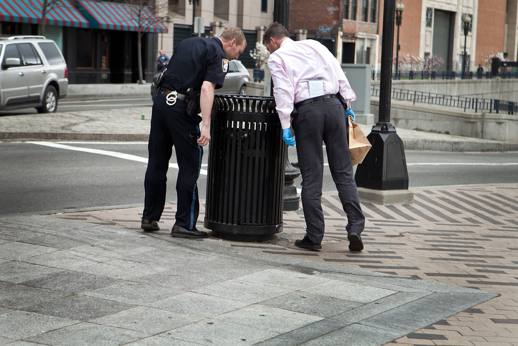 . A Boston Police officer and detective search South Station for suspicious material after two bullets were found outside of the T stop on April 19, 2013 in Boston, Massachusetts. (Photo by Kayana Szymczak/Getty Images)