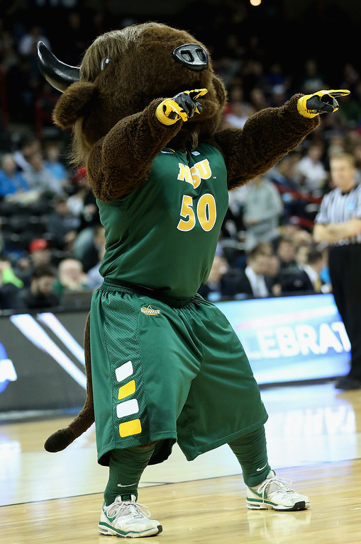 . The North Dakota State Bison mascot, Thundar performs during haltime in the second round of the 2014 NCAA Men\'s Basketball Tournament game against the Oklahoma Sooners at Spokane Veterans Memorial Arena on March 20, 2014 in Spokane, Washington.  (Photo by Stephen Dunn/Getty Images)