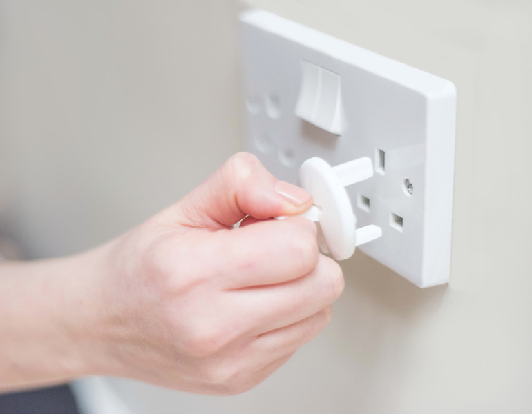 Fred_Home_Safety_Plug_Socket_Cover_Lifestyle_putting_on.jpg
