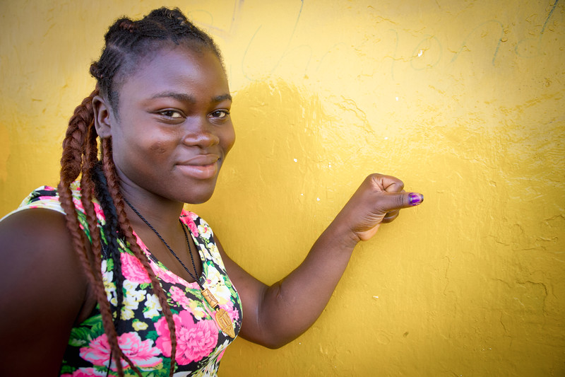 Monrovia, Liberia October 10, 2017 -  A voter shows the ink on her thumb indicating that she has voted.