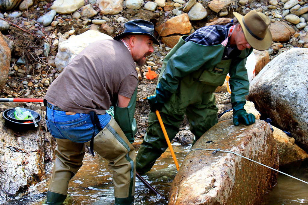 . Chad Watkins and John Self moving a large rock hoping to find a gold deposit in Maine. Ezra Wolfinger/Discovery Communications