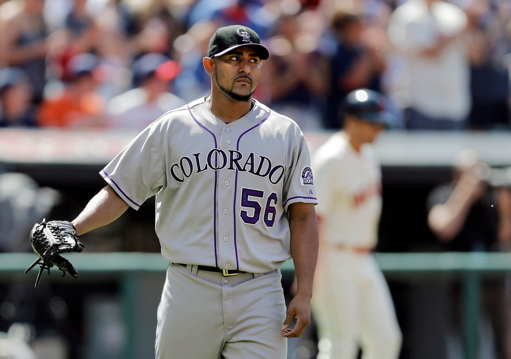 . Colorado Rockies starting pitcher Franklin Morales watches Cleveland Indians\' Mike Aviles round the bases after a three-run home run in the second inning of a baseball game Saturday, May 31, 2014, in Cleveland. (AP Photo/Mark Duncan)