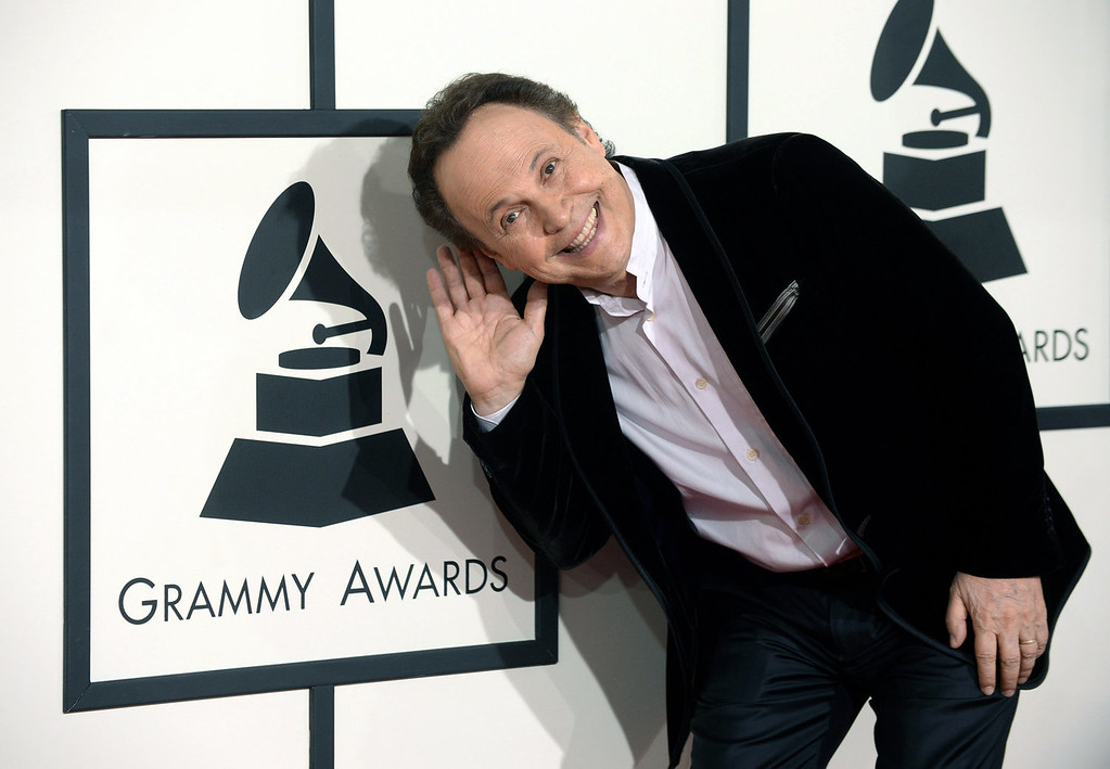 . Billy Crystal arrives for the 56th annual GRAMMY Awards at Staples Center on Sunday, Jan. 26, 2014, in Los Angeles. (Photo by Jordan Strauss/Invision/AP)