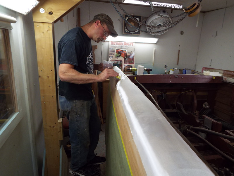 Applying the first coat of epoxy over the glass cloth.