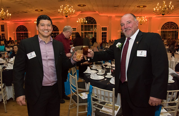 02/06/19 Wesley Bunnell | Staff The Southington YMCA held their 90th Annual Celebration and Recognition dinner at the Aqua Turf Club on Wednesday evening. Person of the Year John DeMello, R, toasts with is son Air Force Major John DeMello Jr. before the start of the ceremony.