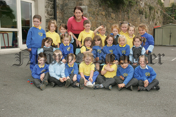 Picture with their teacher Therese Carragher are thw new Primary 1 class at Bunscoil an Luir. 07W37N13